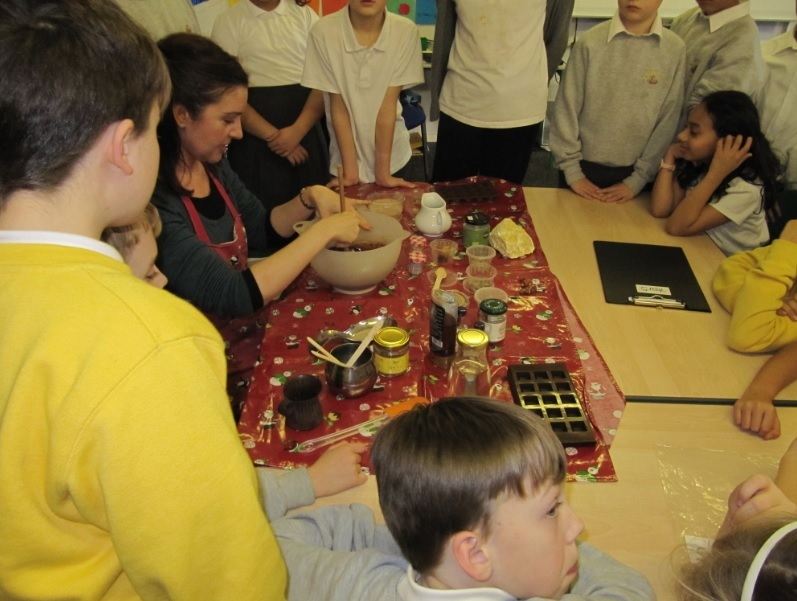 Children from St Bartholomew's Church of England School, Ann Street, Brighton, crowd around for the chocolate workshop